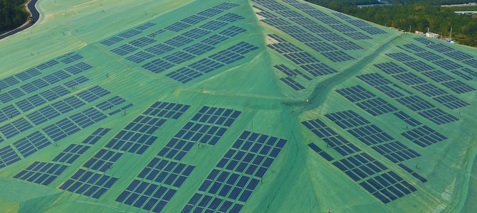 What is a solar energy landfill cover system?